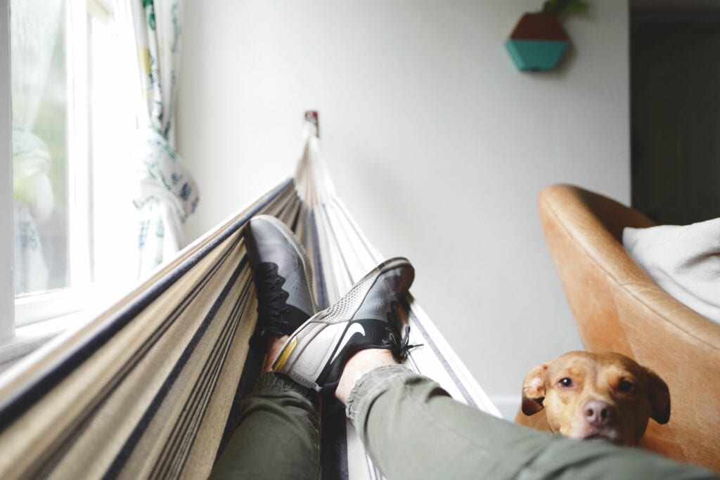 man with his feet up in a hammock for light housekeeping services